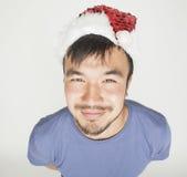 Asiático exótico Papá Noel de Funy en Años Nuevos rojos Imágenes de archivo libres de regalías