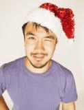 Asiático exótico Papá Noel de Funy en la sonrisa roja del sombrero de los Años Nuevos Imagen de archivo libre de regalías