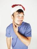 Asiático exótico Papá Noel de Funy en la sonrisa roja del sombrero de los Años Nuevos Foto de archivo libre de regalías