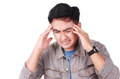Asiático joven Guy Suffering Headache fotografía de archivo libre de regalías