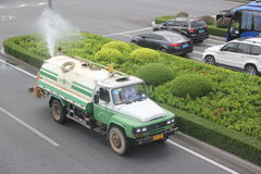 Asia,china,shenzhen,The Sanitation workers are watering Royalty Free Stock Image