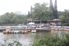 Asia,China,the Pleasure boat Rent point in Shenzhen litchi Park. The pleasure boat Rent point on the dock, and there are many small boats. in Shenzhen litchi Royalty Free Stock Images