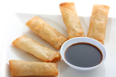 Asia. Spring rolls  with soy sauce on a withe background Royalty Free Stock Photo