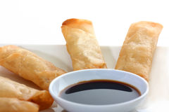 Asia. Spring rolls  with soy sauce on a withe background Royalty Free Stock Photos