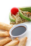 Asia. Spring rolls with soy sauce and a salad Royalty Free Stock Photography