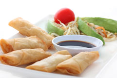 Asia. Spring rolls with soy sauce and a salad Stock Photo