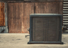 Asia air conditioner compressor installed on wooden background with copy space for text. Royalty Free Stock Photos