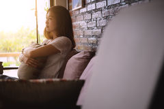 Asia Attractive woman sitting on the couch Royalty Free Stock Image