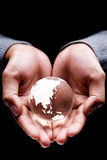 Asia and Australia continent. Hands holding a glass globe showing Asia and Australia continent Royalty Free Stock Photo