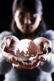 Asia and Australia continent. A woman holding a glass globe showing Asia and Australia continent Stock Photos