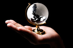 Asia and Australia continent. Single hand holding a glass globe showing Asia and Australia continent Royalty Free Stock Photography