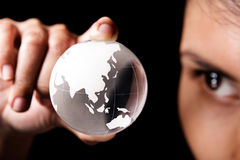 Asia and Australia continent. A woman examining a glass globe which showing Asia and Australia continent Royalty Free Stock Image