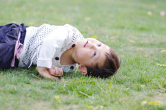 Asia baby. Lovely chinese children to playing on grass Stock Photo