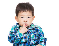 Asia baby boy bite finger Stock Photo