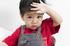 Asia Baby Boy catch fever on white bed. Royalty Free Stock Images