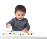 Asia baby boy concentrate on drawing. Isolated on white Royalty Free Stock Images