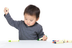 Asia baby boy concentrate on drawing. Isolated on white Royalty Free Stock Image