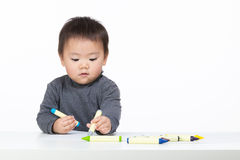 Asia baby boy concentrate on drawing isolated. On white Stock Images