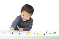 Asia baby boy concentrate on drawing. Isolated on white Stock Images