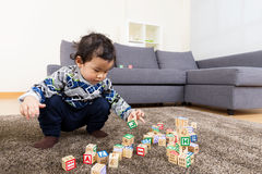 Asia baby boy concentrate on playing toy block Stock Photography
