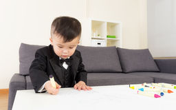 Asia baby boy drawing Royalty Free Stock Photo