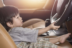 Asia Baby Boy driving  in luxury car copy space. Royalty Free Stock Photo