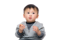 Asia baby boy eating biscuit Stock Image