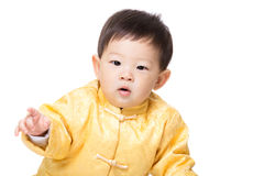 Asia baby boy with golden chinese costume Royalty Free Stock Photography
