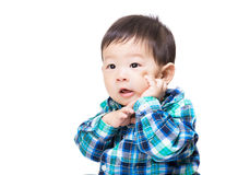 Asia baby boy hand touch his face Royalty Free Stock Photos