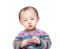 Asia baby boy hold with his necklace Stock Photo