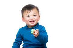 Asia baby boy holding wooden toy block Royalty Free Stock Photos