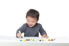 Asia baby boy love drawing Stock Photography