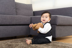 Asia baby boy play doll Stock Photos