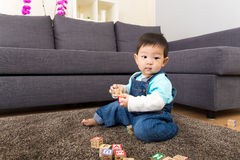 Asia baby boy play wooden toy block Royalty Free Stock Images