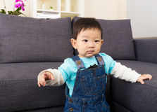 Asia baby boy pointing to front Royalty Free Stock Image