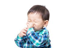 Asia baby boy suck finger into mouth. Isolated on white Royalty Free Stock Images