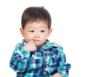 Asia baby boy suck finger into mouth Stock Photo