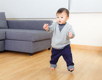Asia baby boy try to walk. At home royalty free stock images