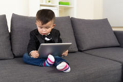 Asia baby boy using tablet Royalty Free Stock Photo