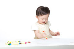 Asia baby concentrate on drawing. Isolated on white Royalty Free Stock Image