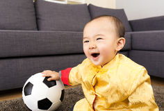 Asia baby feeling excited with soccer ball Stock Images