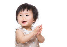 Asia baby girl clapping hand Royalty Free Stock Images