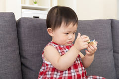 Asia baby girl concentrate on playing toy block Royalty Free Stock Photo