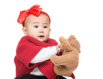 Asia baby girl with doll Royalty Free Stock Photo