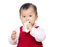 Asia baby girl eating biscuit Stock Images