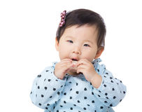 Asia baby girl eating candy Stock Images