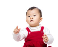 Asia baby girl finger pointing toward Royalty Free Stock Photo
