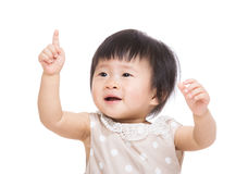 Asia baby girl finger pointing up Royalty Free Stock Image