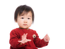 Asia baby girl hand up Stock Photography