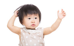 Asia baby girl hands up and touch her head Stock Photo